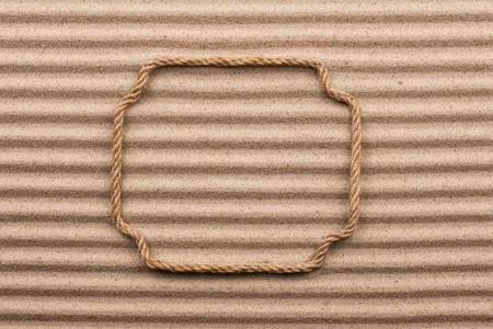 undulating: Frame made of rope, lying on the undulating sand
