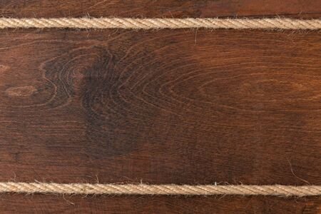 fixed line: Rope on wooden dark  background, with place for your text