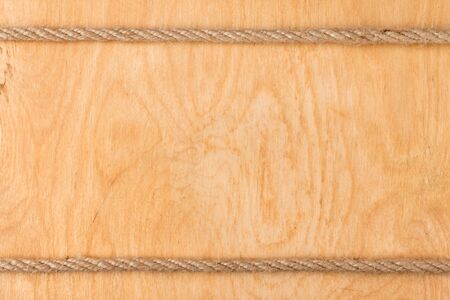 fixed line: Rope on  light wooden background, with place for your text Foto de archivo