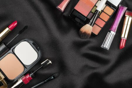 black silk: Beautiful picture of cosmetic  on black silk, with space for your text Stock Photo
