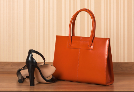 Women black leather shoes with clutch bag Archivio Fotografico