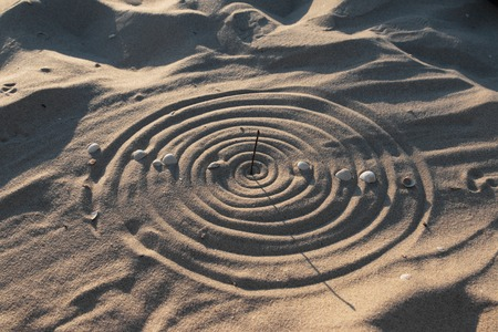 Conceptual sundial on the beach sand, as background Zdjęcie Seryjne