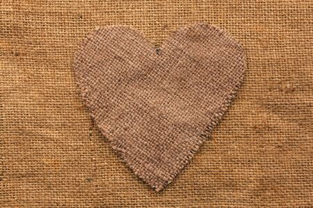 sackcloth: Conceptual image of the heart  lying on sackcloth ,can use as background