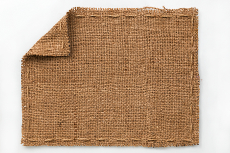 label frame: Frame of burlap with curled edges, lies on a white background, can be used as texture