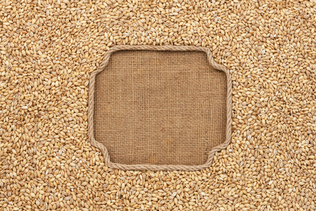 pearl barley: Figured frame made of rope with pearl barley  on sackcloth, with place for your creativity Stock Photo