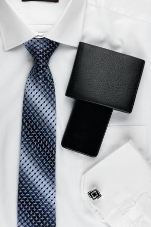mens fashion: Classic style mens fashion, tie, shirt, telephone, as background