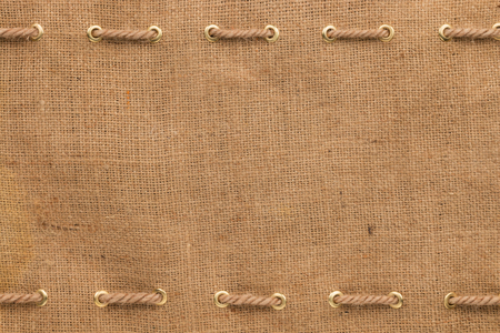Burlap with two lines of rope, with space for your text