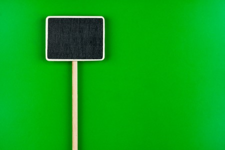 sold small: Pointer with space for your text, lies on green  background Stock Photo