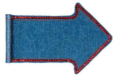 manuscripts: Denim pointer folded in the form of manuscripts, isolated on white background, with red  rhinestones