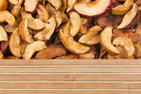 bamboo mat: Dry apple and bamboo mat, with place for your text Stock Photo