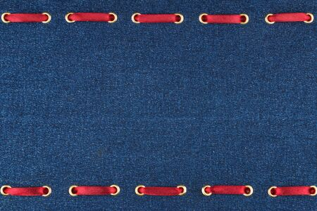 inserted: Fashionable background red satin ribbon inserted in denim, with space for your creativity