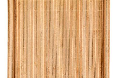 furled: Bamboo mat twisted in the form of a manuscript, Isolated on white background