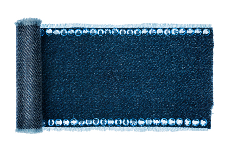 furled: Frame made of denim in the form of a manuscript with blue rhinestones isolated on a white background Stock Photo