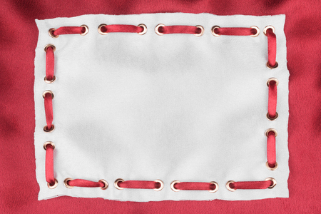 inserted: Frame made of white silk with inserted red satin ribbon, on red silk background