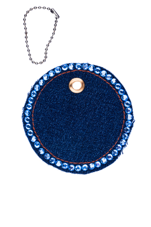 Round price tag encrusted with crystals made of denim, isolated on a white background