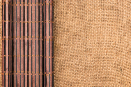 furled: Bamboo mat twisted in the form of a manuscript on sackcloth, with space for your text Stock Photo