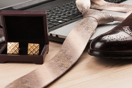Silk tie lying on a laptop, selective focus, as a background