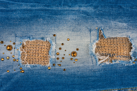 inlaid: Texture of denim fabric with gold threads, inlaid rhinestones. With space for your text