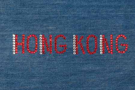 diamond letters: Inscription Hong Kong, inlaid rhinestones on denim. View from above