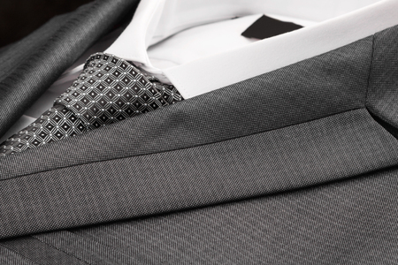 Close-up classic suit, shirt and tie. As a background, texture Stock Photo