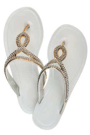 Luxury, decorated with rhinestone white beach flip flops, isolated on a white background Stock Photo