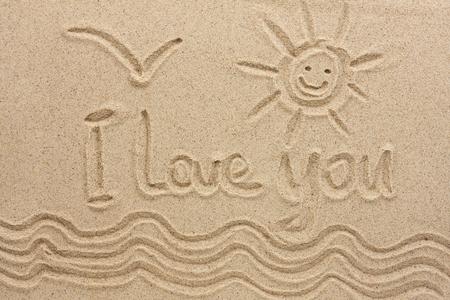 I love you handwritten in sand for natural, love,tourism or conceptual designs. Conceptual image Banco de Imagens