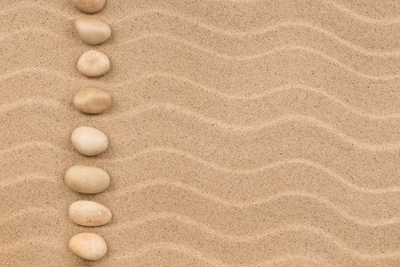 Line made of white stones among sand dunes. Top view