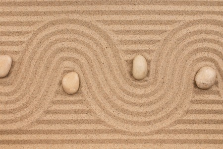 Curve made of sand and white stones. Top view