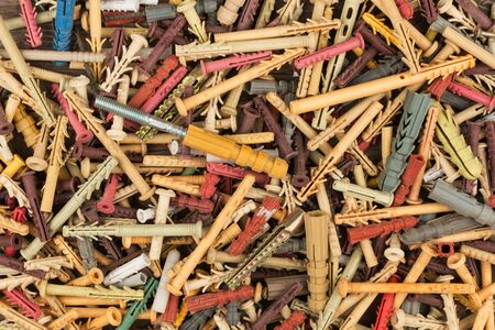 Close-up, dowels. This components called quick installation. Background of dowels. View from above