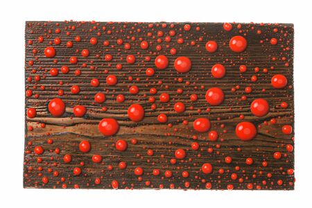 Beautiful colorful water droplets on a wooden frame. Red drops of paint. Top view