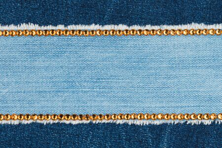 Two strips of rhinestones on denim. With space for design, text place. Top view Stockfoto