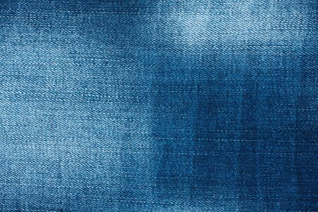 Beautiful denim texture with the effect of aging and scuffs. Fashionable jeans background. Abstract wallpaper horizontal image, with copy space 版權商用圖片
