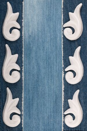 Frame of plaster decorative stucco molding on a denim background. Top view Stockfoto