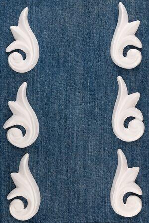 Frame of plaster decorative stucco molding on a denim background. Top view Banco de Imagens