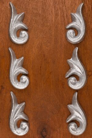 Frame of plaster decorative stucco molding on a wooden background Top view