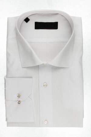 Classic folded white men's shirt isolated on a white background. Fashion and business Foto de archivo - 131400783