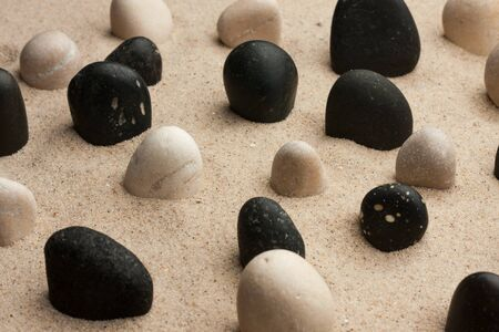 Rock garden. Stones sticking out of the sand in the sunlight. Spa background Banco de Imagens