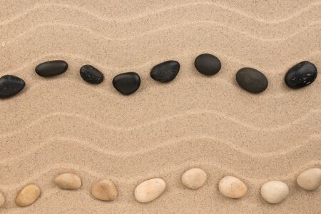 Two line made of stones lying zigzag on the dunes. Top view. Copy space. Banco de Imagens