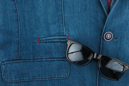 Denim jacket and sunglasses. Fashion and lifestyle. Stock Photo