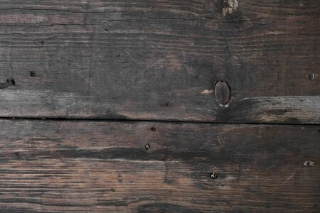 Old wooden boards. Weathered surface and cracks. Top view. Copy space