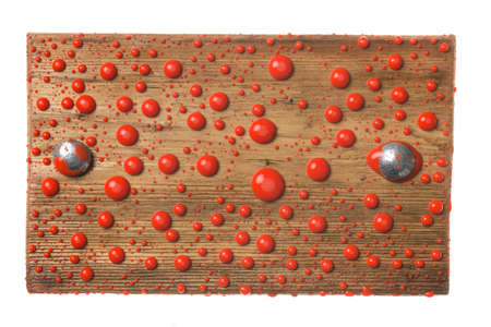 Wooden board with iron bolts in drops of red paint. Isolated on white background Banco de Imagens