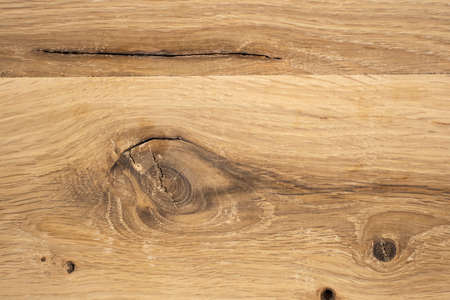 Natural texture of oak. Hardwood with knots and cracks. Top view