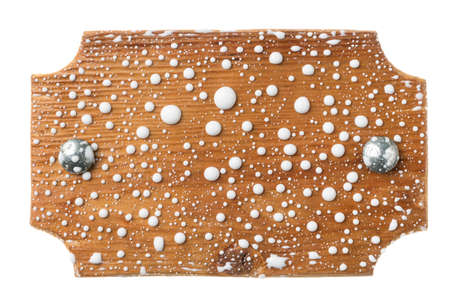 Wooden board with iron bolts in drops of white paint. Isolated on white background Banco de Imagens