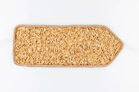 Pointer made of rope, filled with a grain of oat. Isolated on white background