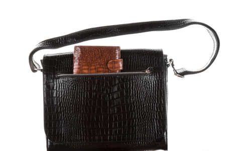 Brown wallet in the pocket of a man's black bag. Isolated on white
