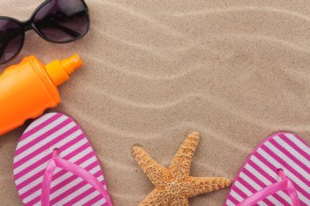 Beach accessories on sand beach. Summer holidays
