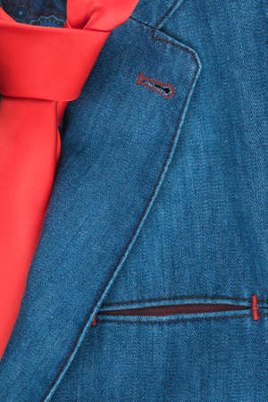 Classic denim suit and red tie, close-up. Top view.