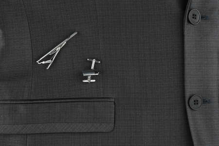 Classic denim suit, cufflinks and clip, close-up. Top view.