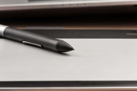 Close-up, stylus lying on a digital tablet for drawing and retouching. Technologies