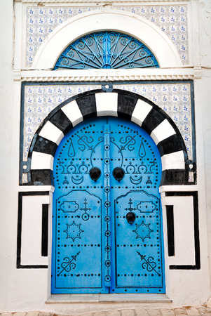 Arched Doorway with Blue Studded Door, Africa, North Africa, Tunisia, Sidi Bou Said